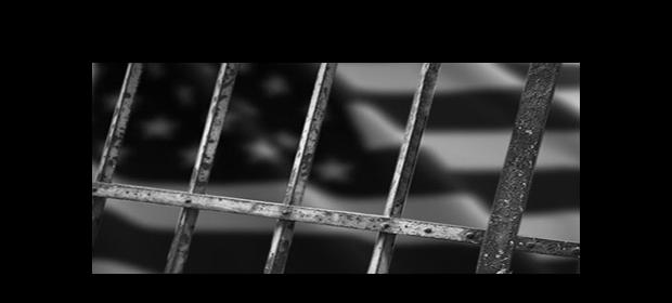american-flag-behind-bars-620