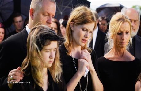 Family-Members-Sad-Funeral-Death-460