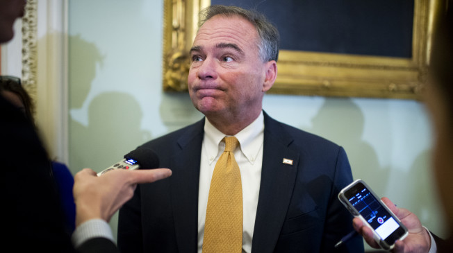 UNITED STATES - NOVEMBER 18: Sen. Tim Kaine, D-Va., talks with reporters outside of the senate luncheons in the Capitol, November 18, 2014. (Photo By Tom Williams/CQ Roll Call) (CQ Roll Call via AP Images)